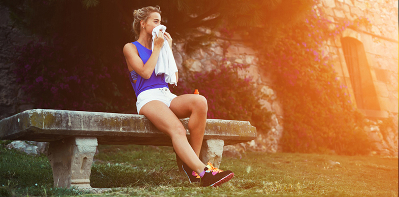 Woman sitting on bench after completing her exercise