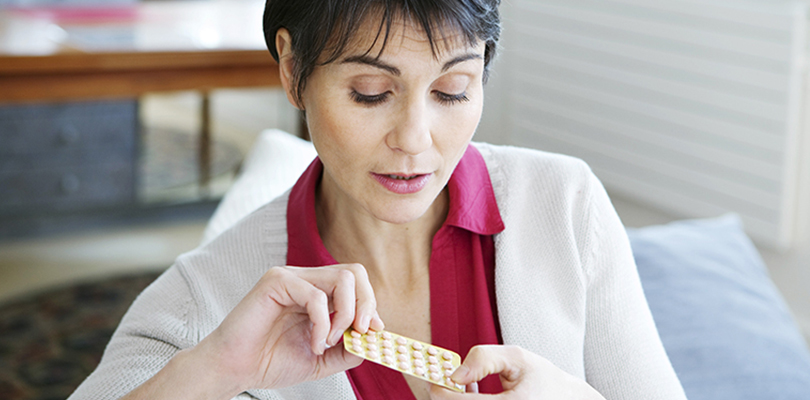 Woman is holding hormone balancing medication