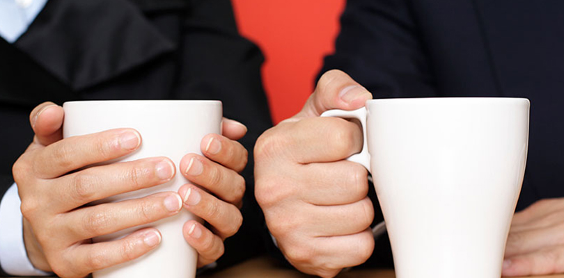 Two people enjoying a cup of coffee together