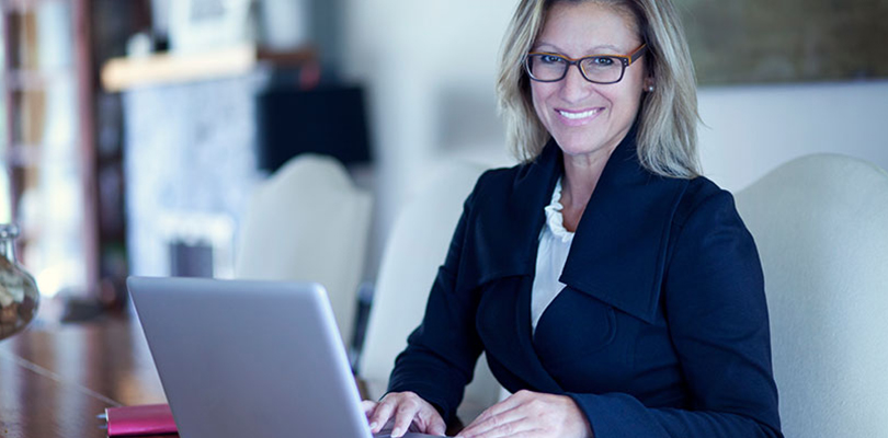 Woman is working at her computer finishing a major project
