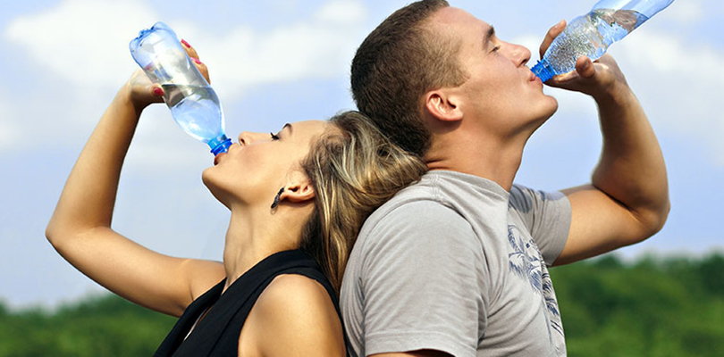 A couple is enjoying their bottled water
