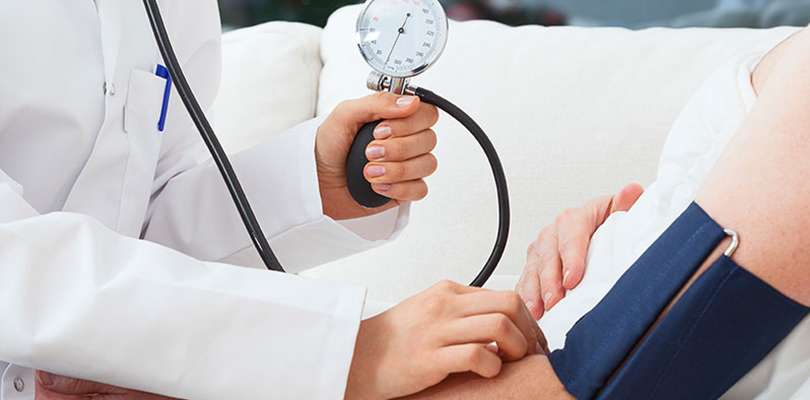 Doctor is taking patient's blood pressure