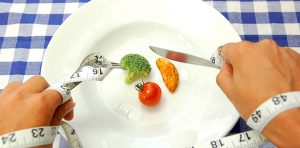 A single plate contains three small vegetables