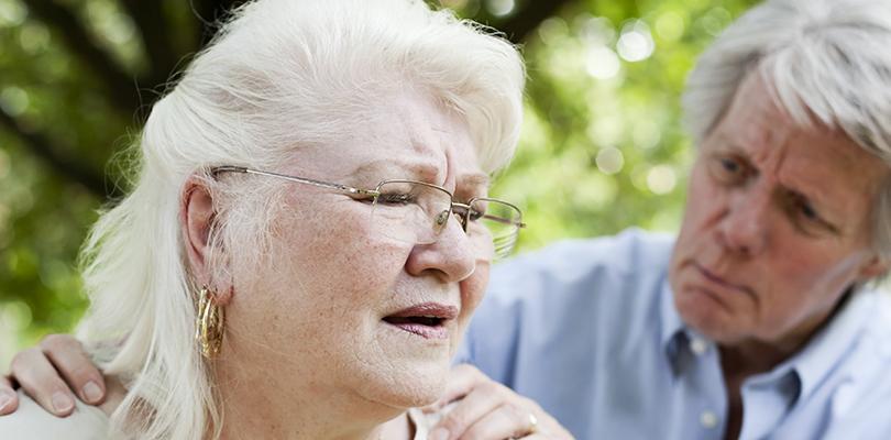 A senior woman experiencing shortness of breath
