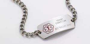 A medical alert bracelet that reads 'Heart Condition, See Wallet Card'
