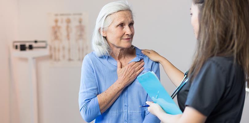 Older woman talks with a nurse