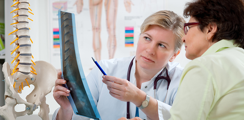 Doctor discusses an x-ray with a patient