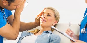 Ophthalmologist examining a woman's eye