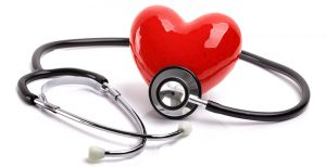 A heart is surrounded by a stethoscope