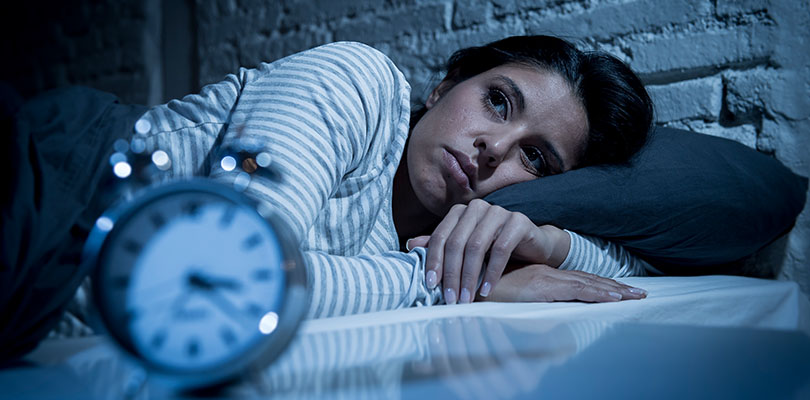 A woman is living with insomnia