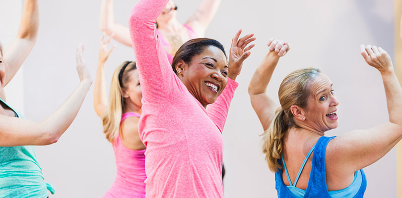 A group of women are exercising together