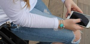 A person is wearing an engraved medical bracelet