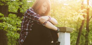 A young woman is looking depressed