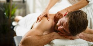 A man is receiving massage therapy
