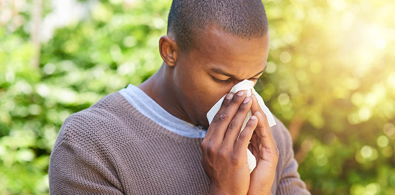 A man is experiencing allergy symptoms