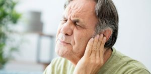 A man is experiencing an ear infection