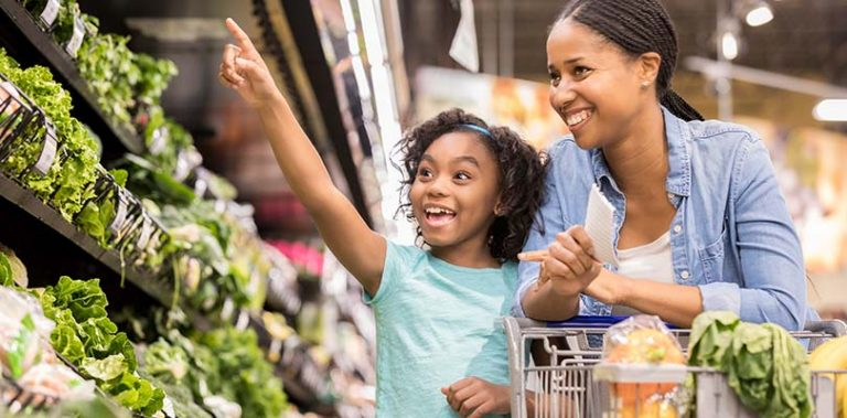 Parent and child are shopping at a supermarket