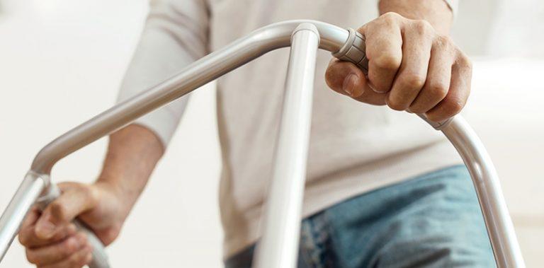 A man is using a walker