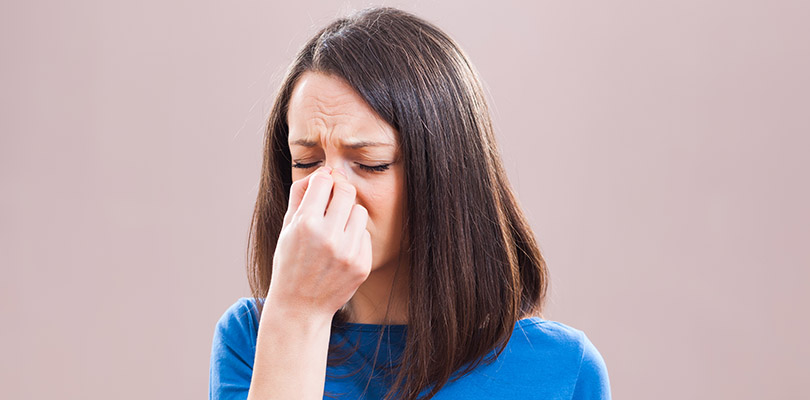 A woman is experiencing sinus problems