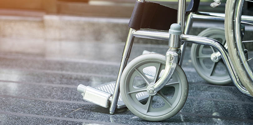 A manual wheelchair is parked.