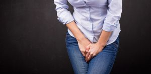 Woman's hands covering her groin