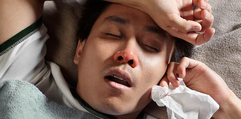 Male has a head cold