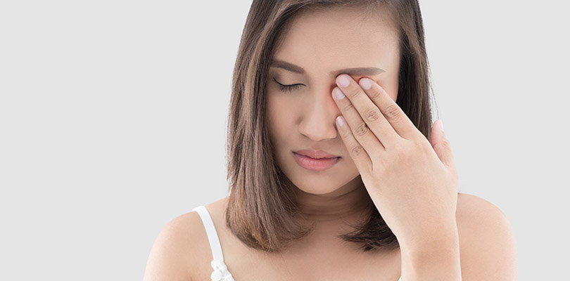 Asian woman suffering from strong eye pain