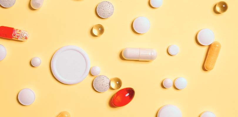 Multivitamins on a yellow background.